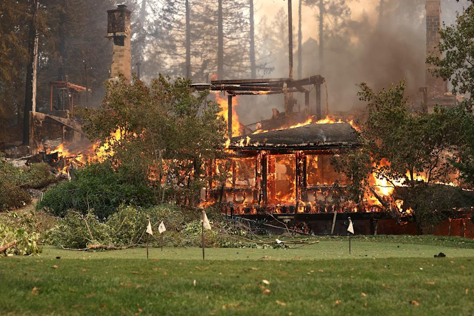 The main building at St. Helena's famous Meadowood Napa Valley luxury resort crumbles from the flames on Monday.