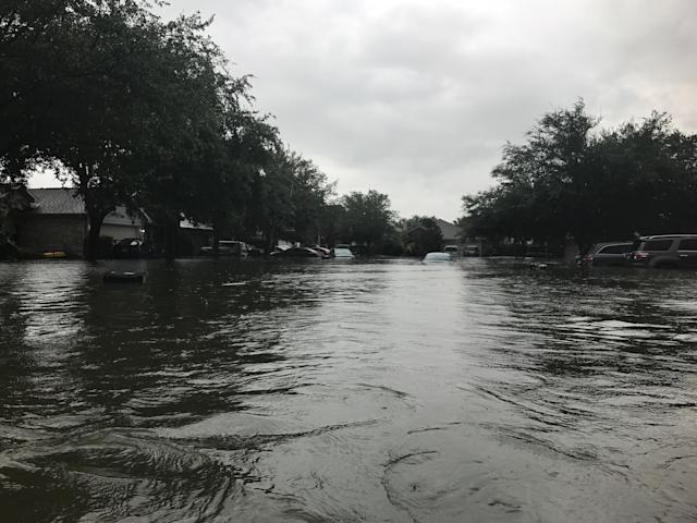 The Rochas waded through this street to get to safety on August 27. The three kids wore life preservers. Photo courtesy of Ashley Rocha.