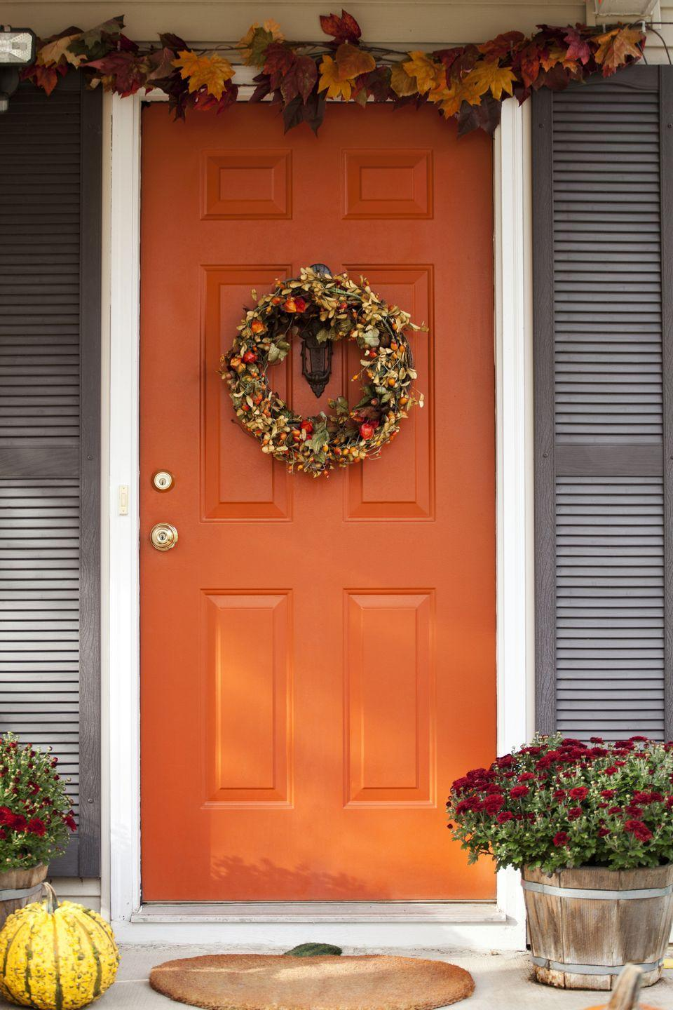 """<p>Opt for a sophisticated Halloween look by lining the top of your door with foliage, hanging a striking wreath, and placing a pumpkin or two near potted floral arrangements. <br><br><a class=""""link rapid-noclick-resp"""" href=""""https://go.redirectingat.com?id=74968X1596630&url=https%3A%2F%2Fwww.etsy.com%2Flisting%2F485606221%2Fpreserved-maple-leaves-choose-your&sref=https%3A%2F%2Fwww.goodhousekeeping.com%2Fholidays%2Fhalloween-ideas%2Fg32948621%2Fhalloween-door-decorations%2F"""" rel=""""nofollow noopener"""" target=""""_blank"""" data-ylk=""""slk:SHOP MAPLE LEAVES"""">SHOP MAPLE LEAVES</a></p>"""