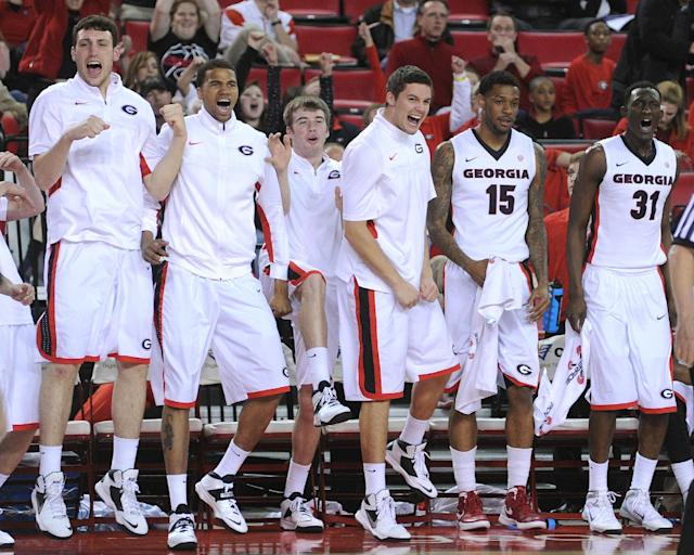 The Georgia bench reacts to a Georgia basket during the second half of an NCAA college basketball game Saturday, Feb. 8, 2014, in Athens, Ga. (AP Photo/The Banner-Herald, Richard Hamm)