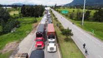 Trucks are seen blocking a road during a protest against the tax reform of President Ivan Duque's government in Zipaquira