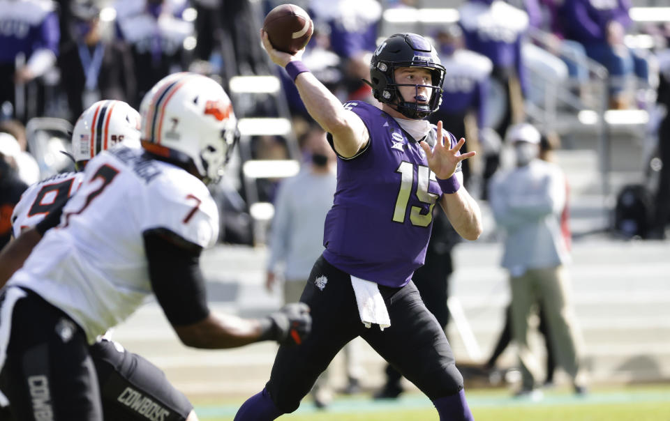 TCU quarterback Max Duggan (15) throws downfield against Oklahoma State during the first half of an NCAA college football game Saturday, Dec. 5, 2020, in Fort Worth, Texas. (AP Photo/Ron Jenkins)
