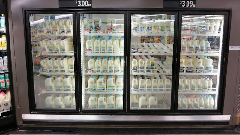 Woolworths Fridges stocked with milk are seen in a Woolworths supermarket on May 24, 2016 in Sydney, Australia. Australians are rallying around it's dairy farmers by opting to purchase branded milk rather than the cheaper store brands after the country's largest dairy company Murray Goulburn last month cut the price it pays suppliers by 15%. (Photo by Getty Images)