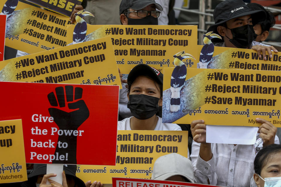 Demonstrators display placards during a protest against the military coup in Yangon, Myanmar Thursday, Feb. 18, 2021. Demonstrators against Myanmar's military takeover returned to the streets Thursday after a night of armed intimidation by security forces in the country's second biggest city. (AP Photo)