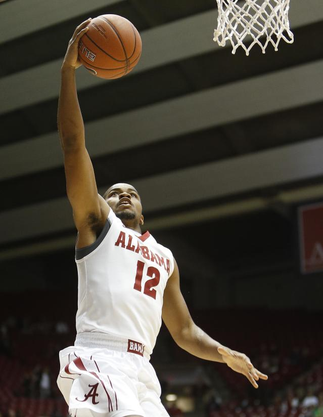 Alabama's Trevor Releford shoots a layup against Texas Tech during the first half of an NCAA college basketball game in Tuscaloosa, Ala., Thursday, Nov. 14, 2013. (AP Photo/The Tuscaloosa News, Robert Sutton)