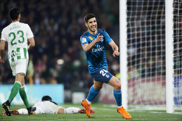 "<a class=""link rapid-noclick-resp"" href=""/soccer/players/marco-asensio/"" data-ylk=""slk:Marco Asensio"">Marco Asensio</a> celebrates his second goal in <a class=""link rapid-noclick-resp"" href=""/soccer/teams/real-madrid/"" data-ylk=""slk:Real Madrid"">Real Madrid</a>'s win over <a class=""link rapid-noclick-resp"" href=""/soccer/teams/real-betis/"" data-ylk=""slk:Real Betis"">Real Betis</a>. (Getty)"