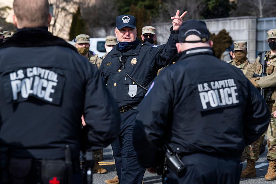 U.S. Capitol Police and National Guard troops conduct a security briefing on Independence Avenue on March 4, 2021. (Photo: Tom Williams via Getty Images)