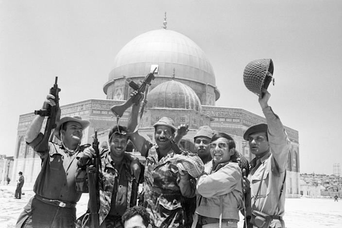 Image: Israeli soldiers celebrate the capture of Old Jerusalem from the Jordanians. They cheer in front of the Dome of the Rock, a mosque sacred to all Muslims. (Bettmann / Getty file)