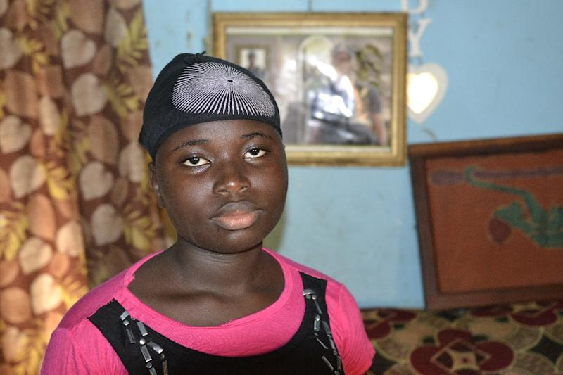 Twelve-year-old Helene Jeanne Komomou, an orphan since her father died in September 2014, is among more than 22,000 children who lost at least one parent to the deadliest Ebola outbreak in history (AFP Photo/Cellou Binani)