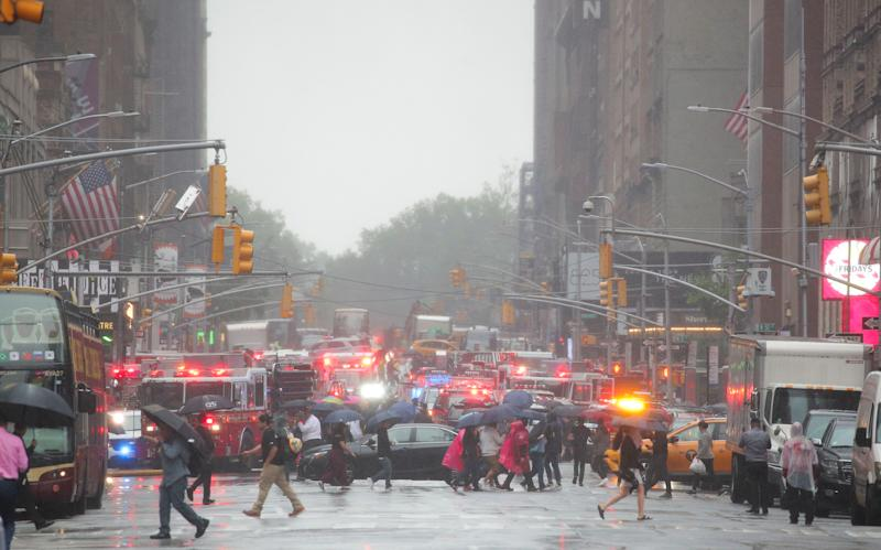 Emergency vehicles fill the street at the scene after a helicopter crashed atop a building in Times Square and caused a fire in the Manhattan borough of New York, New York, U.S., June 10, 2019. REUTERS/Brendan McDermid