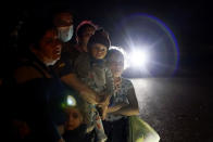 FILE - In this May 17, 2021, file photo a group of migrants mainly from Honduras and Nicaragua wait along a road after turning themselves in upon crossing the U.S. - Mexico border, in La Joya, Texas. Attorney General Merrick Garland has tossed out a Trump administration policy that barred immigration judges from temporarily shelving some deportation cases. Garland on Thursday, July 15, 2021, overruled a decision by then-Attorney General Jeff Sessions that judges couldn't put those cases on hold. (AP Photo/Gregory Bull, File)