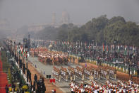 Indian para-military force soldiers march through the ceremonial Rajpath boulevard during India's Republic Day celebrations in New Delhi, India, Tuesday, Jan.26, 2021. Republic Day marks the anniversary of the adoption of the country's constitution on Jan. 26, 1950. (AP Photo/Manish Swarup)