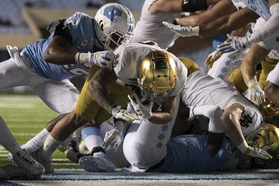 Notre Dame's Kyren Williams (23) scores on a one-yard against North Carolina during an NCAA college football game, Friday, Nov. 27, 2020, at Kenan Stadium in Chapel Hill, N.C. (Robert Willett/The News & Observer via AP)
