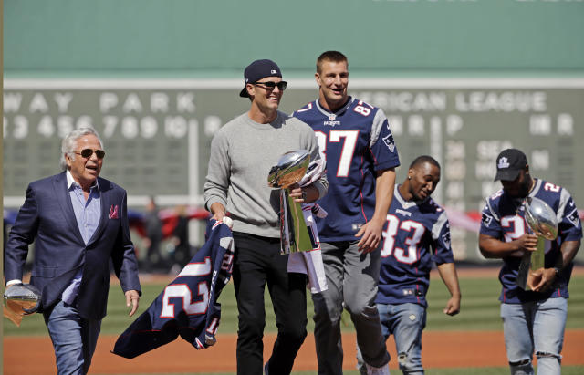 Patriots QB Tom Brady, center, teammates and owner Robert Kraft brought the Lombardi Trophy to Fenway Park last year. A member of the Red Sox said on Thursday following Brady's workout methods has helped him. (AP)