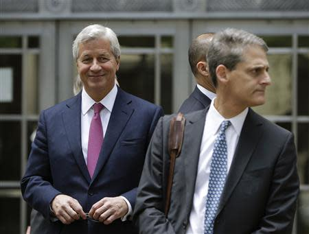 J.P. Morgan CEO Dimon leaves the U.S. Justice Department after meeting with Attorney General Holder, in Washington
