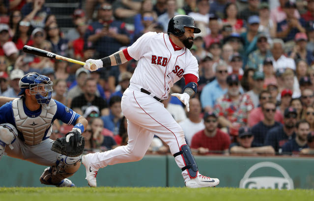 Boston Red Sox's Sandy Leon follows through on a hit against the Toronto Blue Jays during the ninth inning of a baseball game Saturday, July 14, 2018, in Boston. (AP Photo/Winslow Townson)