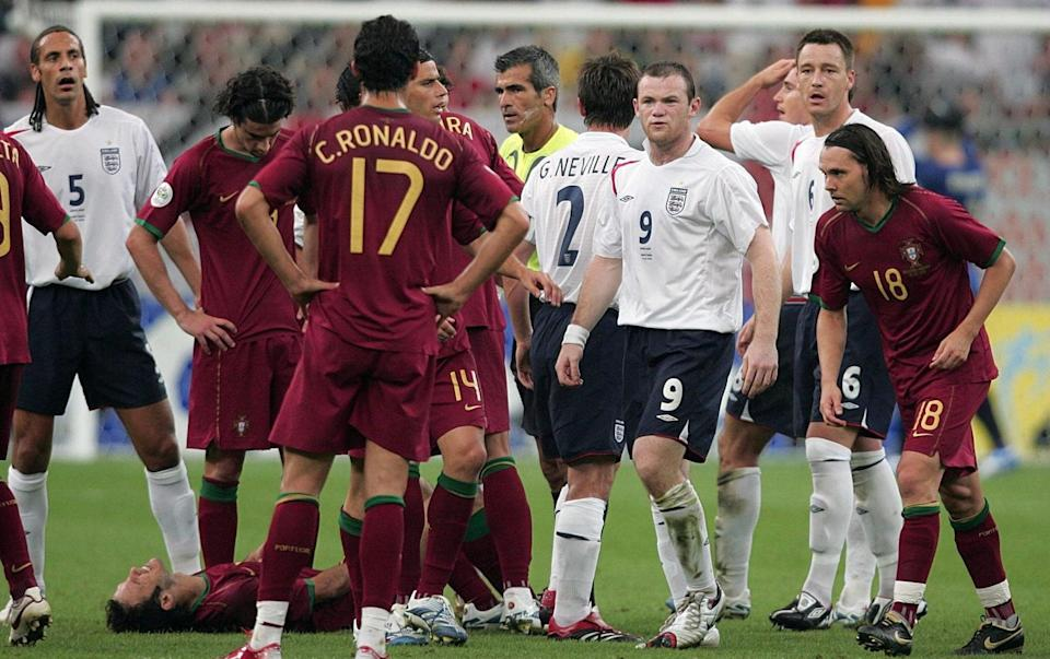 Wayne Rooney glares at Portugal's Cristiano Ronaldo after being sent off. - PA