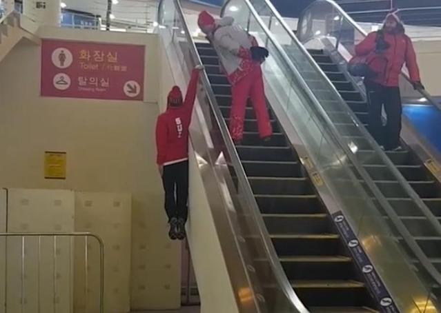 Fabian Bösch rides the escalator rail at the Olympics. (Instagram/@buhsch)