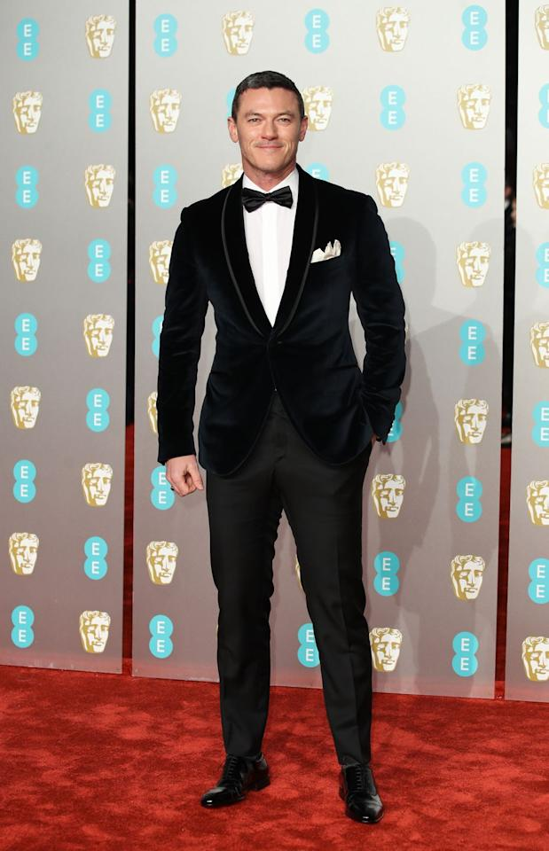 <p>Since the littlest details make for a Very Stylish Man, it pays to sweat the small stuff. Which is exactly what Luke Evans did, making a subtle switch from silk to velvet (by way of Corneliani) for one big look.<br> </p>