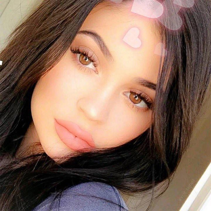 "<p>""Morning ????,"" was the simple caption <a rel=""nofollow"" href=""https://www.instagram.com/p/BbFDTytlg1A/"">on a Nov. 4 selfie</a> shared to makeup mogul Kylie's Instagram account, showing off her pink pout decorated with a matching hearts filter.</p>"