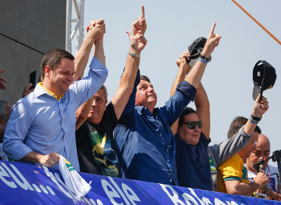 Brazilian President Jair Bolsonaro (C) and Vice-President Hamilton Mourao (R) are seen during a demonstration to support their government, amidst Brazil's Independence Day, in Brasilia on September 7, 2021. - Fighting record-low poll numbers, a weakening economy and a judiciary he says is stacked against him, President Jair Bolsonaro has called huge rallies for Brazilian independence day Tuesday, seeking to fire up his far-right base. (Photo by Sergio Lima / AFP) (Photo by SERGIO LIMA/AFP via Getty Images)