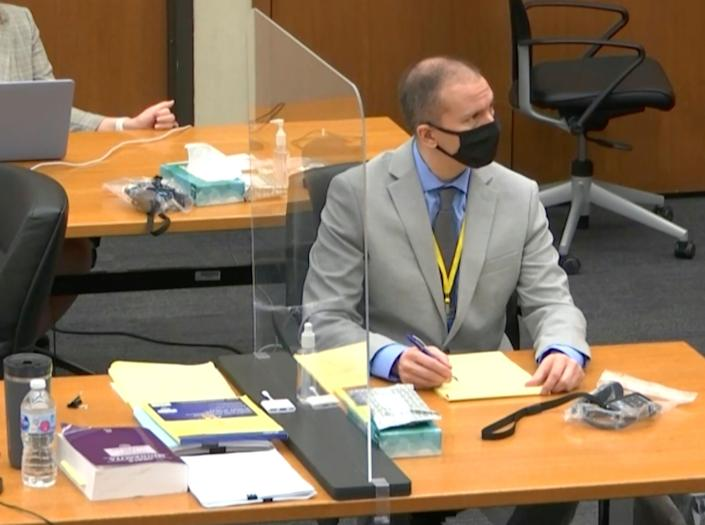 In this image from video, defendant and former Minneapolis police officer Derek Chauvin, right, listens as Hennepin County Judge Peter Cahill presides over pretrial motions before jury selection Tuesday, March 9, 2021 at the Hennepin County Courthouse in Minneapolis.  Chauvin is charged in the May 25, 2020 death of George Floyd.