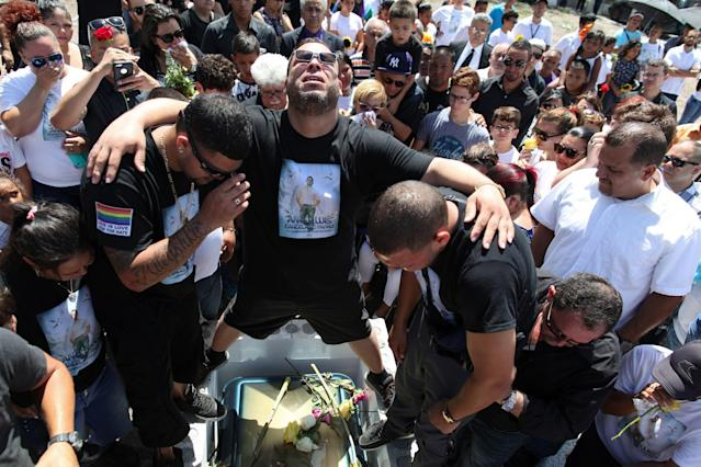 <p>Family and friends attend the funeral of Angel Candelario, one of the victims of the shooting at the Pulse night club in Orlando, Fla., at his hometown of Guanica, Puerto Rico, June 18, 2016. (Reuters/Alvin Baez) </p>