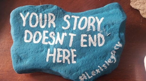 One of the rocks painted for Lexi's Legacy, a campaign to raise awareness about mental health.  (Submitted by Chris Daken - image credit)