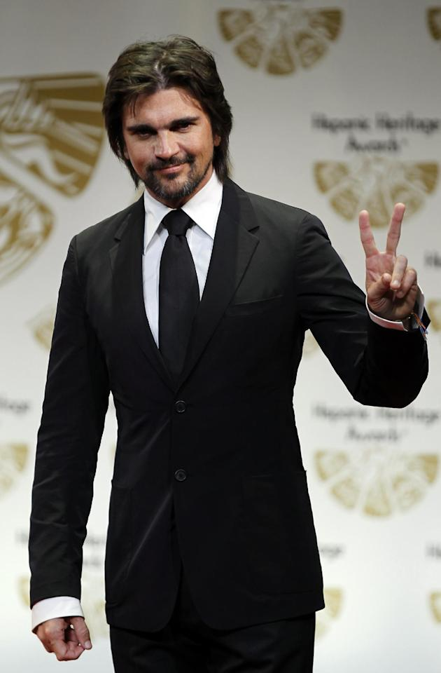 Vision award nominee Juanes gestures during a news conference at the 25th Annual Hispanic Heritage Awards, Thursday, Sept. 15, 2011, in Washington.(AP Photo/Luis M. Alvarez)