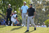 Phil Mickelson, right, watches his shot from the 12th tee with Xander Schauffele, left, and Max Homa during the first round of the U.S. Open Golf Championship, Thursday, June 17, 2021, at Torrey Pines Golf Course in San Diego. (AP Photo/Marcio Jose Sanchez)