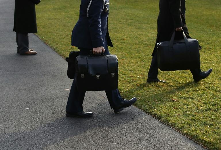The nuclear football bag goes everywhere the president goes, carried by a military aide