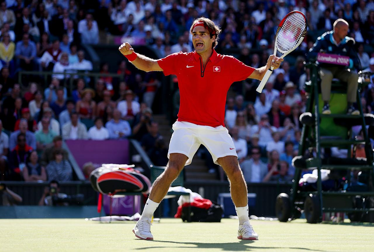 LONDON, ENGLAND - AUGUST 03:  Roger Federer of Switzerland celebrates his 4-6, 7-6, 19-17 win over Juan Martin Del Potro of Argentina in the Semifinal of Men's Singles Tennis on Day 7 of the London 2012 Olympic Games at Wimbledon on August 3, 2012 in London, England.  (Photo by Clive Brunskill/Getty Images)