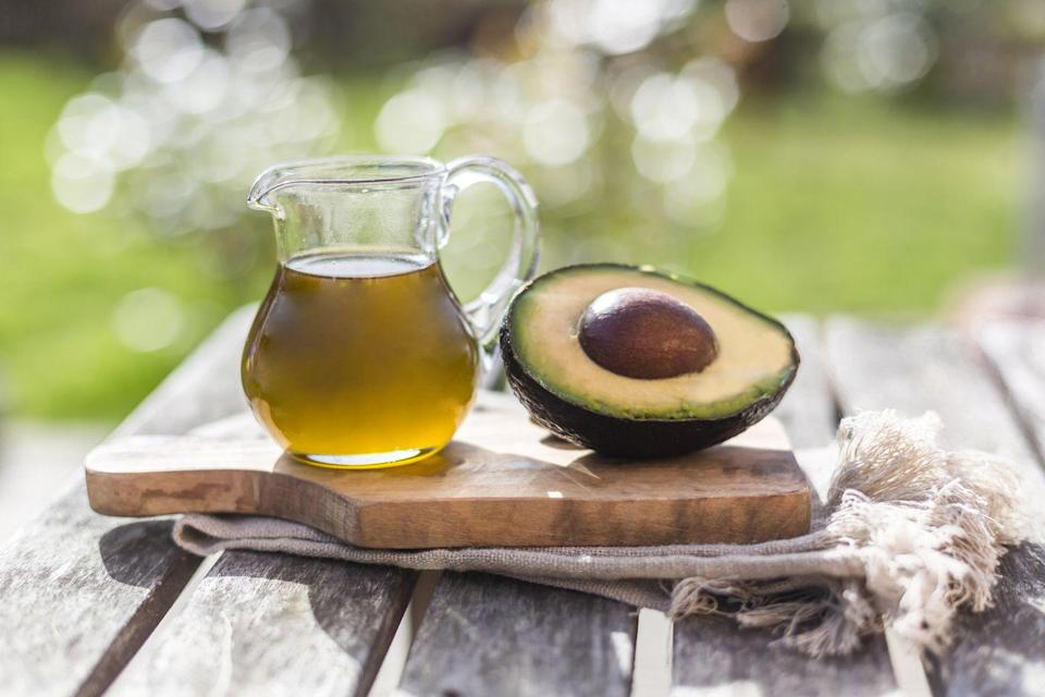 """<p>Avocado oil is an oil extracted from the pulp of the <a href=""""https://www.goodhousekeeping.com/health/diet-nutrition/a47998/avocado-nutrition/"""" rel=""""nofollow noopener"""" target=""""_blank"""" data-ylk=""""slk:avocado fruit"""" class=""""link rapid-noclick-resp"""">avocado fruit</a>, and is a healthy, delicious alternative to vegetable oil. With its high smoke point and creamy, buttery flavor, this oil is perfect for just about any cooking uses in the kitchen, including <a href=""""https://www.goodhousekeeping.com/food-recipes/g413/great-grilling-recipes/"""" rel=""""nofollow noopener"""" target=""""_blank"""" data-ylk=""""slk:grilling"""" class=""""link rapid-noclick-resp"""">grilling</a>, stir-frying, and sautéing as well as for baking and making dressings or marinades.</p>"""