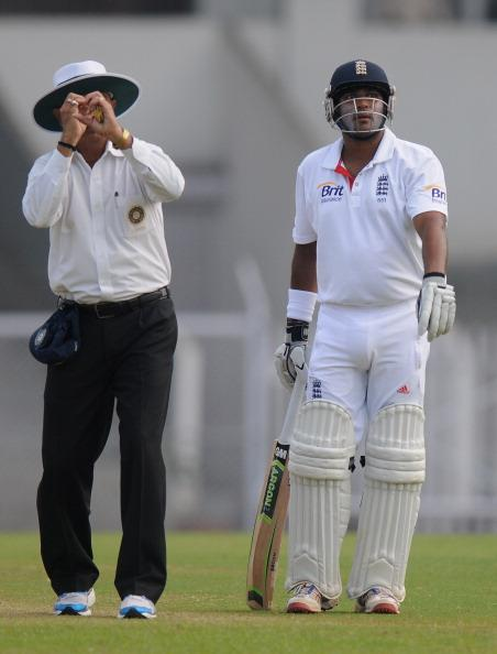 MUMBAI, INDIA - NOVEMBER 01:  Field umpire (L) getures towards a camera person as Samit Patel of England (R) looks on during the final day of the first practice match between England and India 'A' at the CCI (Cricket Club of India) ground, on November 1, 2012 in Mumbai, India.  (Photo by Pal Pillai/Getty Images)