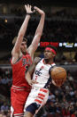 Washington Wizards guard Bradley Beal, right, drives to the basket against Chicago Bulls forward Luke Kornet during the first half of an NBA basketball game in Chicago, Wednesday, Jan. 15, 2020. (AP Photo/Nam Y. Huh)