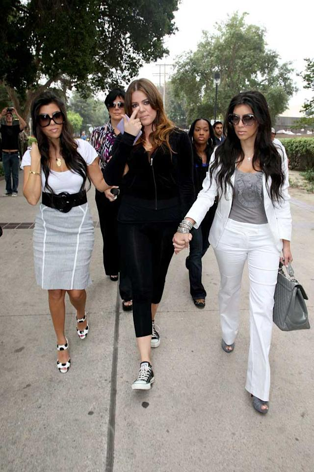 """Khloe Kardashian was joined by sisters Kourtney (left) and Kim (right) as she made her way to jail on Friday for violating her probation stemming from a DUI in 2007. The reality star was released from jail after just 173 minutes. In more good news for the family, E! picked up the siblings' show """"Keeping Up With The Kardashians"""" for a third season. <a href=""""http://www.infdaily.com"""" target=""""new"""">INFDaily.com</a> - July 13, 2008"""