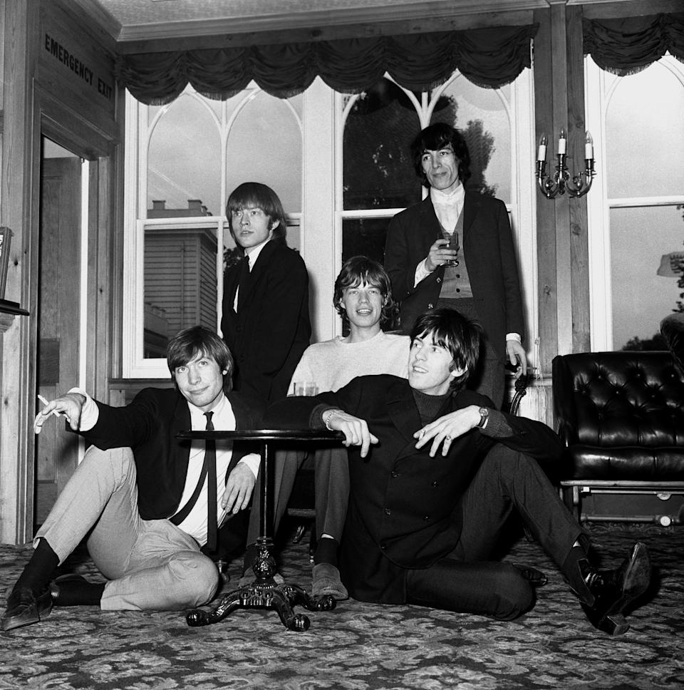 The Rolling Stones, (left to right), Charlie Watts, Brian Jones, Mick Jagger, Keith Richards and Bill Wyman (behind) seen in 1964. Source: PA Wire/AAP
