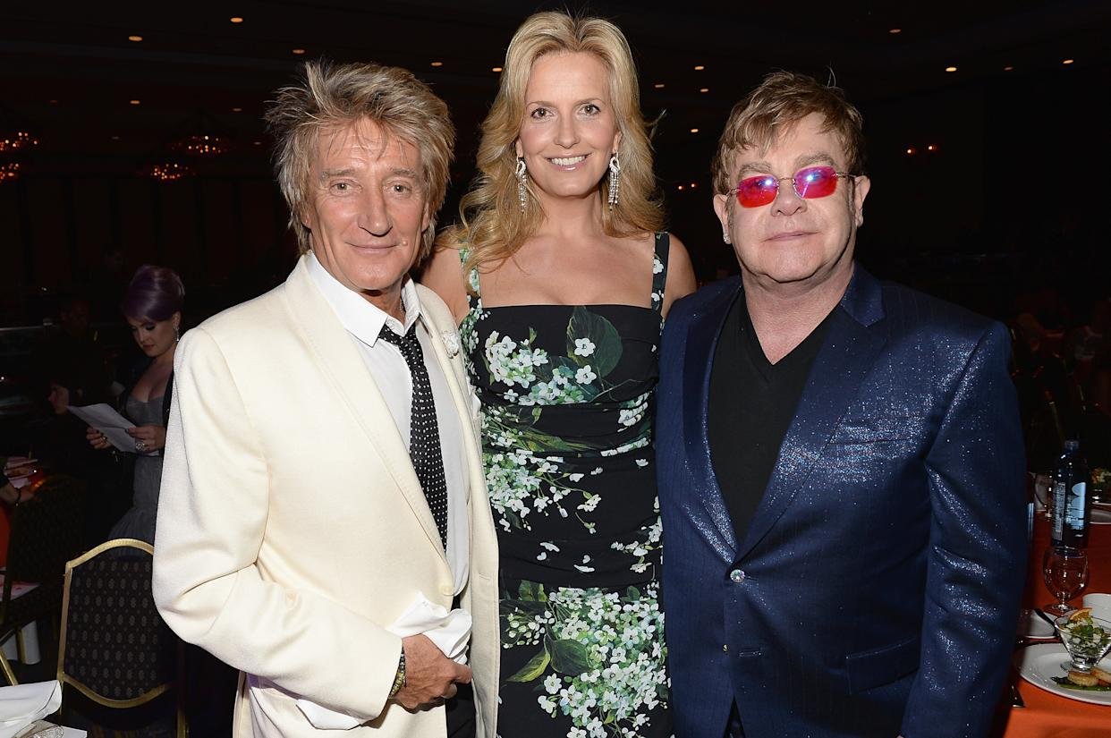 """CENTURY CITY, CA - MAY 03: (L-R) Musician Rod Stewart, Penny Stewart and musician Elton John attend the 20th Annual Race To Erase MS Gala """"Love To Erase MS"""" at the Hyatt Regency Century Plaza on May 3, 2013 in Century City, California.  (Photo by Michael Buckner/Getty Images for Race To Erase MS)"""