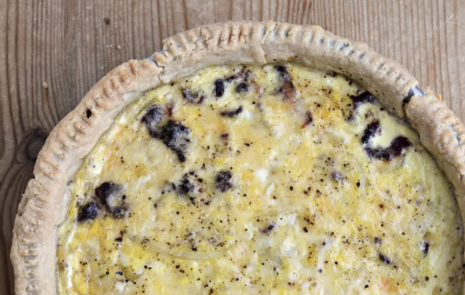"""<p>Quiche Lorraine is a French bistro classic traditionally made with lots of eggs, bacon, Gruyère and onion. You can always make a shortcut version with store-bought crust, but you should try to make it the <a href=""""https://www.thedailymeal.com/cook/unbelievable-retro-recipes-gallery?referrer=yahoo&category=beauty_food&include_utm=1&utm_medium=referral&utm_source=yahoo&utm_campaign=feed"""" rel=""""nofollow noopener"""" target=""""_blank"""" data-ylk=""""slk:old-fashioned way"""" class=""""link rapid-noclick-resp"""">old-fashioned way</a> at least once for the sake of authenticity. You can bake any kind of quiche up to three days in advance, just let it come to room temperature before reheating it in the oven on low. The crust can also be blind-baked up to a couple days prior and stored at room temperature. </p> <p><a href=""""https://www.thedailymeal.com/recipes/quiche-lorraine-no-pork-recipe?referrer=yahoo&category=beauty_food&include_utm=1&utm_medium=referral&utm_source=yahoo&utm_campaign=feed"""" rel=""""nofollow noopener"""" target=""""_blank"""" data-ylk=""""slk:For the Quiche Lorraine recipe, click here."""" class=""""link rapid-noclick-resp"""">For the Quiche Lorraine recipe, click here.</a></p>"""