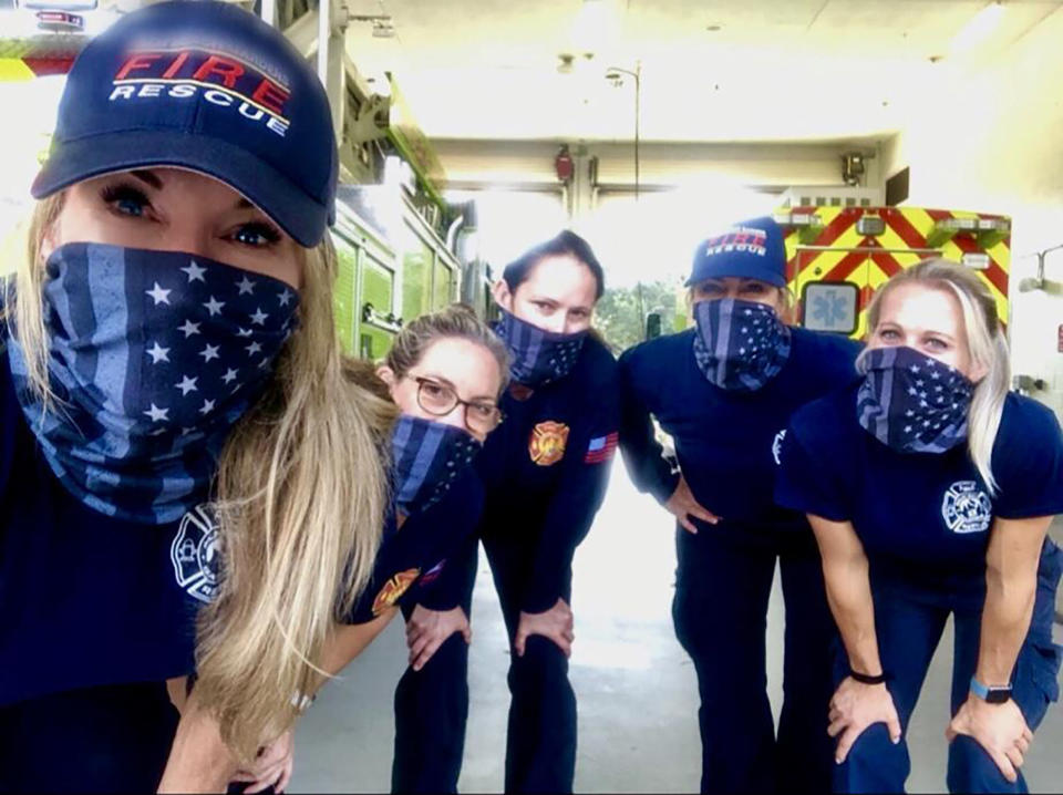 In this September 2020 photo provided by Palm Beach Gardens Fire and Rescue, firefighters from left to right, Julie Dudley, Sandi Ladewski, Monica Marzullo, Krystyna Krakowski and Kelsey Krzywada pose at their station in Palm Beach Gardens, Fla. The women who made history by working an entire firefighting shift with no men are still thriving at their fire department in Florida months later. The members of the team at Palm Beach Gardens Fire Rescue say they've succeeded in a heavily male-dominated profession for a couple of reasons. One is that their male colleagues and supervisors have enthusiastically supported them. (Krystyna Krakowski/Palm Beach Gardens Fire and Rescue via AP)
