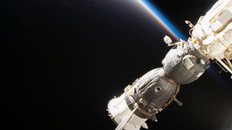 Russian space capsule with three astronauts docks at the International Space Station