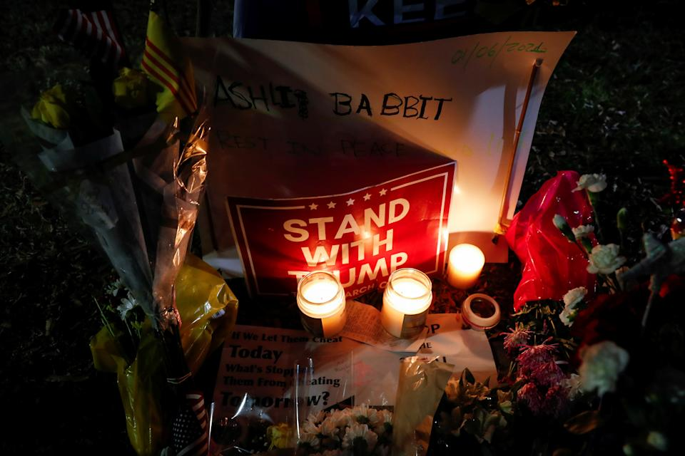Flowers and candles are seen at a memorial for Ashli Babbitt, the woman who was shot dead at the U.S. Capitol after a mob of President Trump's supporters stormed the building on Jan. 6, 2021. (Shannon Stapleton/Reuters)
