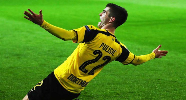 Christian Pulisic celebrates after scoring a goal for Borussia Dortmund during a Champions League Round of 16 game. (Getty)