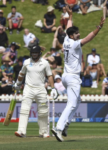 India's Ishant Sharma, right, successfully appeals the wicket of New Zealand's Tom Latham for 11 during the first cricket test between India and New Zealand at the Basin Reserve in Wellington, New Zealand, Saturday, Feb. 22, 2020. (AP Photo/Ross Setford)