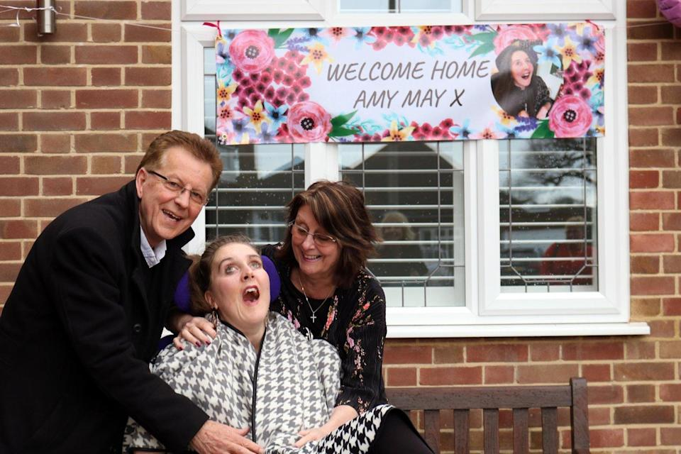 Amy May Shead, at home with her parents Roger and Sue (Amy May Trust)