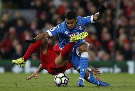 Liverpool's Dejan Lovren in action with Bournemouth's Joshua King  Reuters / Andrew Yates