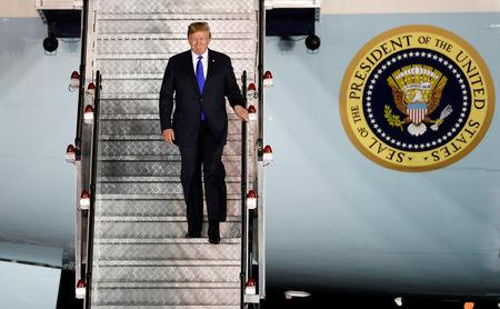 FILE PHOTO: U.S. President Donald Trump steps off his plane as he arrives at Paya Lebar Air Base in Singapore