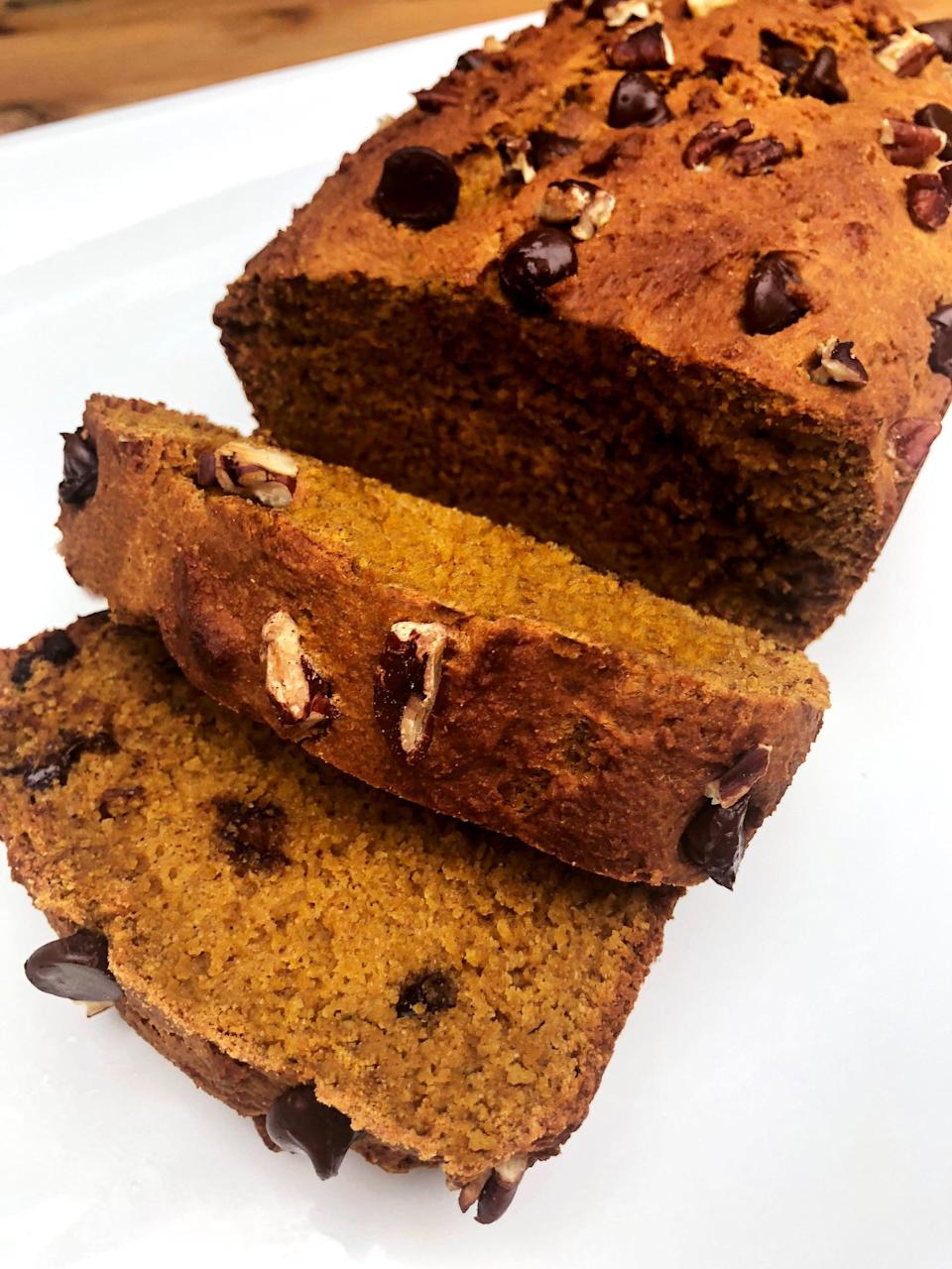 """<p>This easy pumpkin bread recipe has half the sugar and over twice the protein of a typical recipe, offering 9.2 grams of protein per moist and delicious slice.</p> <p><strong>Get the recipe:</strong> <a href=""""https://www.popsugar.com/fitness/Protein-Pumpkin-Bread-Recipe-45269886"""" class=""""link rapid-noclick-resp"""" rel=""""nofollow noopener"""" target=""""_blank"""" data-ylk=""""slk:vegan chocolate-chip pumpkin bread"""">vegan chocolate-chip pumpkin bread</a></p>"""