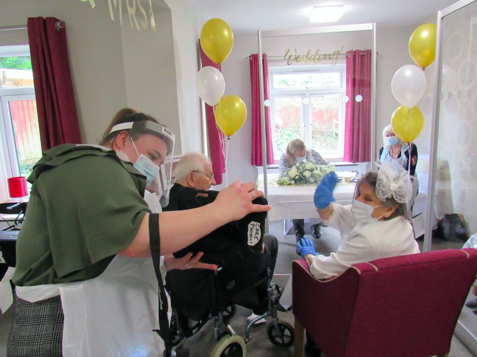 Care home staff helped make the ceremony COVID-secure. (SWNS)