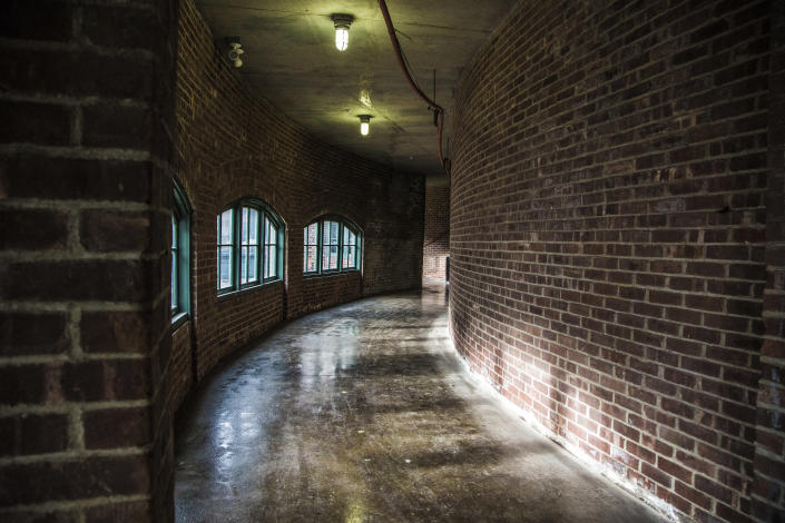 <p>The restored curved corridors leading to the laundry room from the Ferry House of Ellis Island. (Photo: Gordon Donovan/Yahoo News) </p>